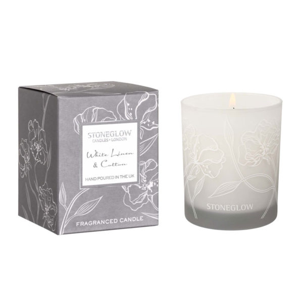 white linen and cotton candle