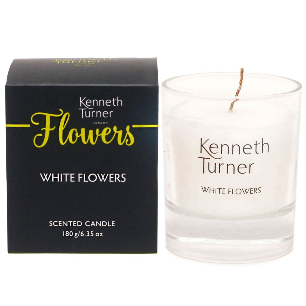 white flowers candle in glass